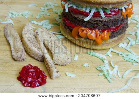 Dessert Imposter Cheeseburger And Apple Fries On Cutting Board