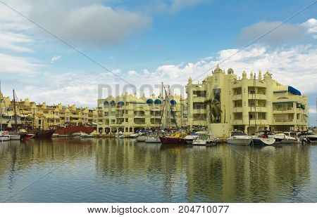 Benalmadena Spain August 30 2017: Luxury boats and apartments in Marina Bay Benalmadena Costa del Sol Malaga province Andalucia Spain.