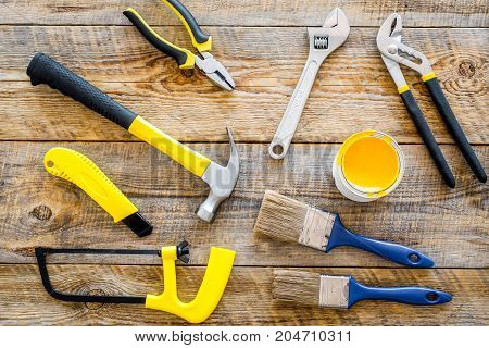 house renovation with implements set for building, painting and repair on wooden table background top view
