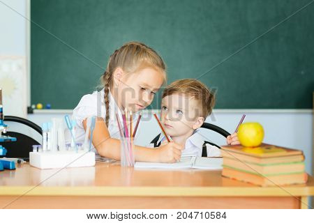 Cute Girl And Her Little Brother Learning Together