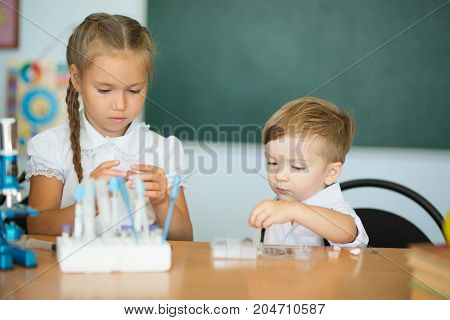 Cute Kids Studying, Smart Girl And Boy Doing Home Work