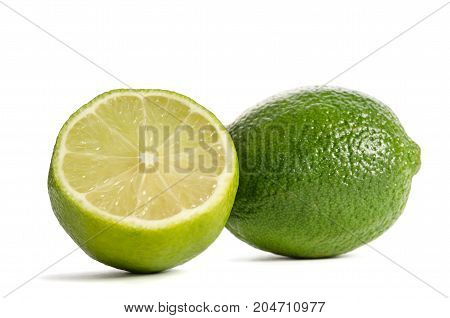 One Lime With Half Of A Juicy Lime Isolated On White Background