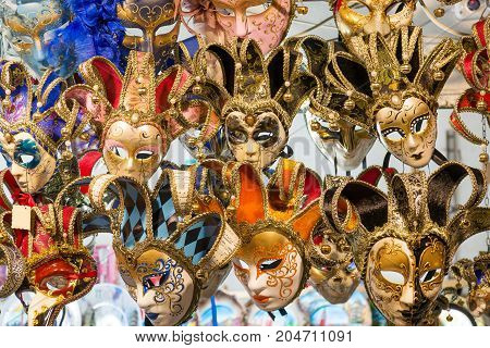 Beautiful Venetian masks background. Street shop in Venice Italy outdoors. Tourism and travel concept