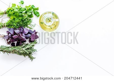 natural oil and fresh greenery for restaurant cooking with spices on white kitchen table background top view space for text