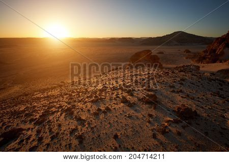 Valley in the Sinai desert with mountain rock at sunset
