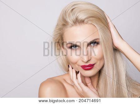 Charming smiling blonde woman close up shot