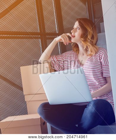 Young Redhead Woman With Moving Boxes And Laptop