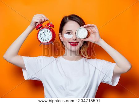 Woman Using Eye Patch For Her Eyes And Care Lips On Orange Background