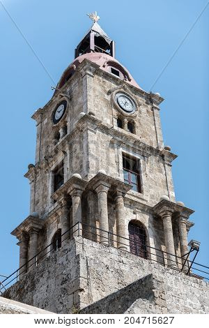 Old bell tower with watches in Rhodes town on Rhodes island, Greece