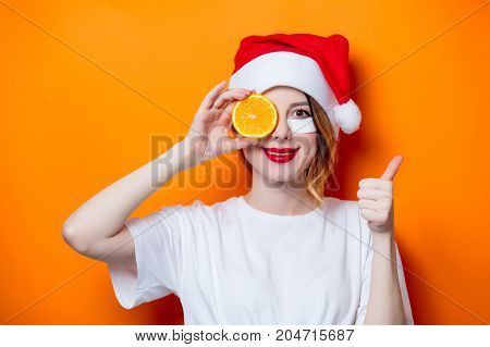 Woman Using Eye Patch For Her Eyes In Santa Claus Hat With Cytrus