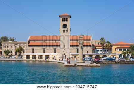 Old Venetian watch tower at old seaport of Rhodes island, Greece