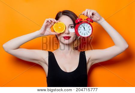 Woman Using Eye Patch For Her Eyes With Cytrus And Alarm Clock