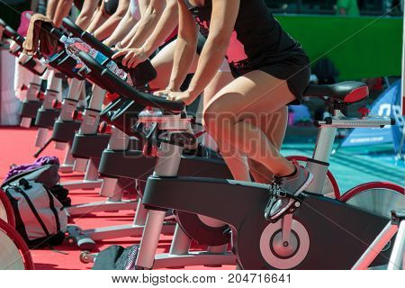 Rimini, Italy - may 2015: Group of Boys and Girls at Gym: Workout with Spinning Bikes
