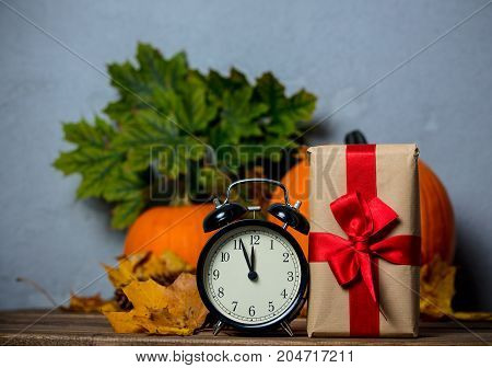 Alarm Clock With Leaves And Pumpkin With Halloween Gift Box