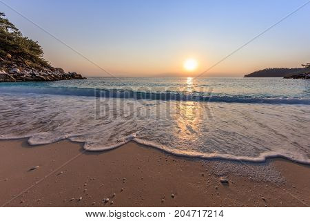 Sunrise in Marble beach (Saliara beach) Thassos Islands Greece. The most beautiful white beach in Greece