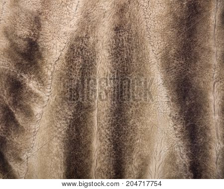 Brown faux fur west like art background, texture