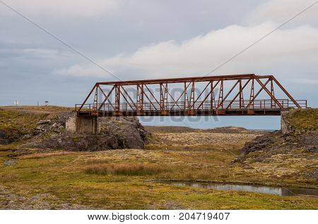 Old Bridge Over Heinabergsfljot River In Iceland. Due To Glacier Melting The River Has Changed Route