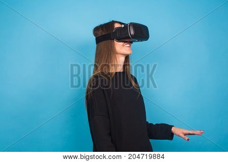 Young woman wearing virtual reality device. Technology, virtual reality and people concept.