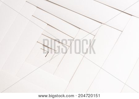Paper geometric composition, abstract background. Creative composition of white sheets, labyrinth pattern, copy space