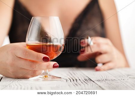 Drunk Woman In Lace Underwear With Glass Of Whiskey