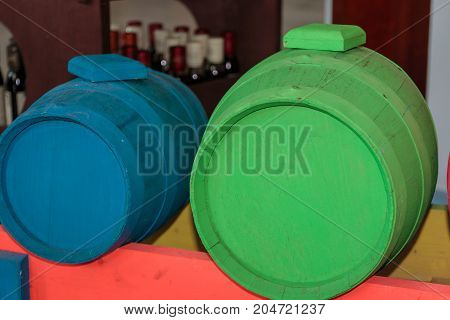 Antique Barrel Painted In Fluorescent Colors: Blue And Green