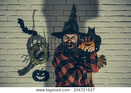 Halloween Man With Pumpkin In Dark Shadow