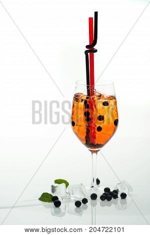 Drink and food. Party and summer vacation. Alcoholic beverage and currant berry at restaurant. Cocktail with blueberry isolated on white background. Drinking straw in cocktail glass at bar.