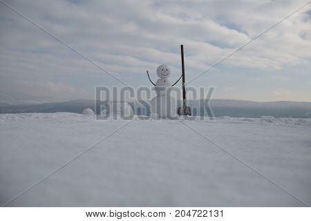 Snowman With Shovel.