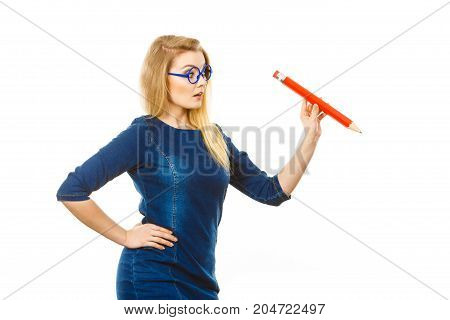 Positive Woman Holds Big Pencil In Hand