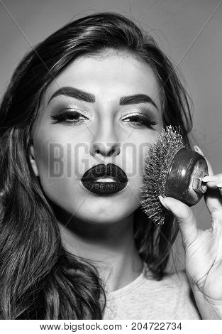 Sexy Woman With Red Lips, Long Hair Holds Iron Brush