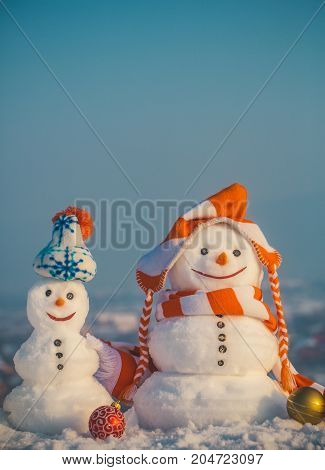 Snowmen In Hats On Natural Background