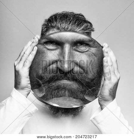 Bearded Man With Magnifying Glass