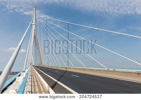 Highway with footpath at Pont de Normandie French bridge over river Seine near Le Havre and Honfleur