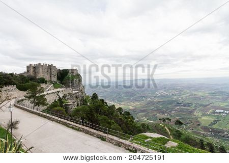 Castle dedicated to goddess Venus on Erice mountain. In the background the plain of Trapani