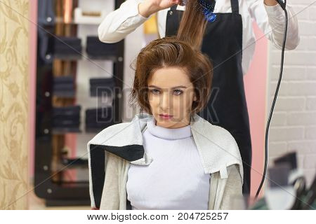 Lady at the hairdresser. Pretty caucasian woman.