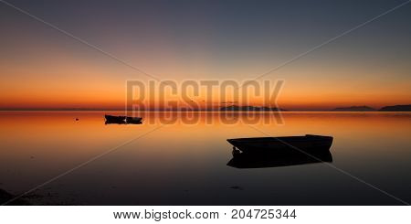 The Islands in the background are the Egadi Islands province of Trapani Sicily Italy; the sea is the one near the historical salt flats of this wonderful province of the mediterranean coast