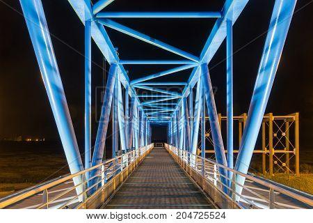 Night shot footbridge over toll booth near Pont de Normandie in France
