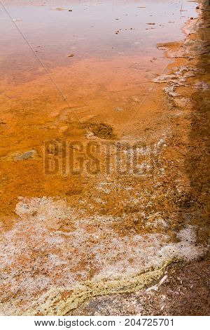 Detail of a salt flat with visible water and earth. This abstract detail is taken in the historical salt flats of Trapani sicilian city famous for the salt production one of his oldest economic activities