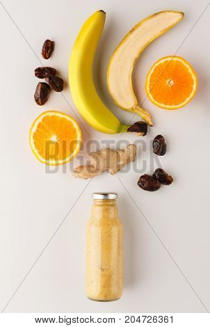 Healthy food. Detox smoothie with ingredients on white background, top view, copy space.
