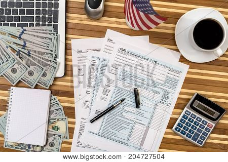 Tax Form With Coffee, Laptop, Pen And Calculator And Dollar