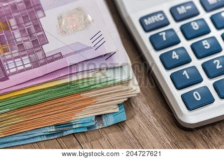 euro bills with calculator . close up