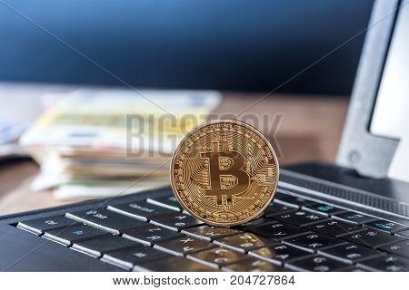 Dollar, Euro, Bitcoin And Laptop, Close Up