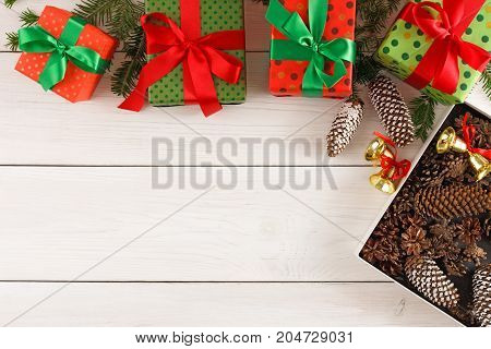 Creative presents in craft and grey paper decorated for any holiday concept. Gift boxes, top view with copy space on rustic table background. Red, green ribbons for christmas. Copy space