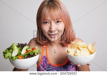 Beautiful Asian Healthy Girl Salad And Potato Chips.