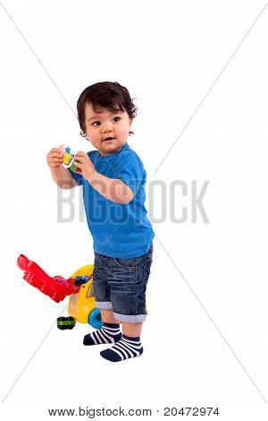 Beautiful And Happy Baby Playing, On White Background, Studio Shot