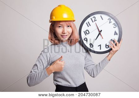 Asian Engineer Woman Thumbs Up With A Clock.