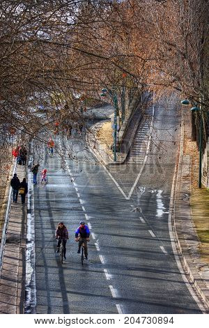 France, Paris - Spring 2008: Cyclists on crossroad of Pont Marie and Voie Georges Pompidou