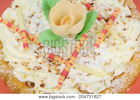 Nougat bavarois with flower in wafer paper and white chocolate sticks as decoration