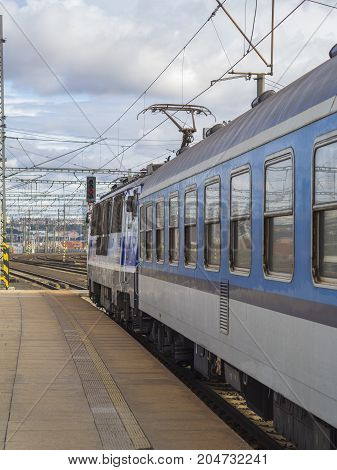 blue train with diesel locomotive on empty platform in train station in hradec kralove in czech republic