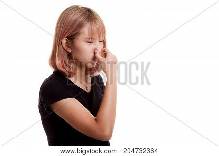 Young Asian Woman  Holding Her Nose Because Of A Bad Smell.